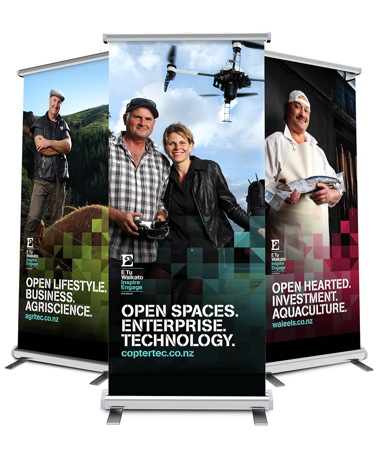 Three pull-up banners showcasing the various promotional photos and accompanying art.
